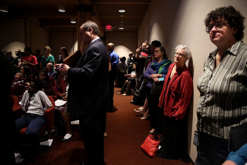 "People stand against a wall during a meeting at the Dallas County Commissioners Court in Dallas on Tuesday, Feb. 7, 2017. More than a dozen D-FW advocacy groups gathered in support of a ""Welcoming Communities"" "" resolution, which serves as a proclamation to all residents that Dallas County supports immigrant, refugee, and marginalized communities, documented and undocumented, and values them as integral members of our community.  (Rose Baca/The Dallas Morning News)"