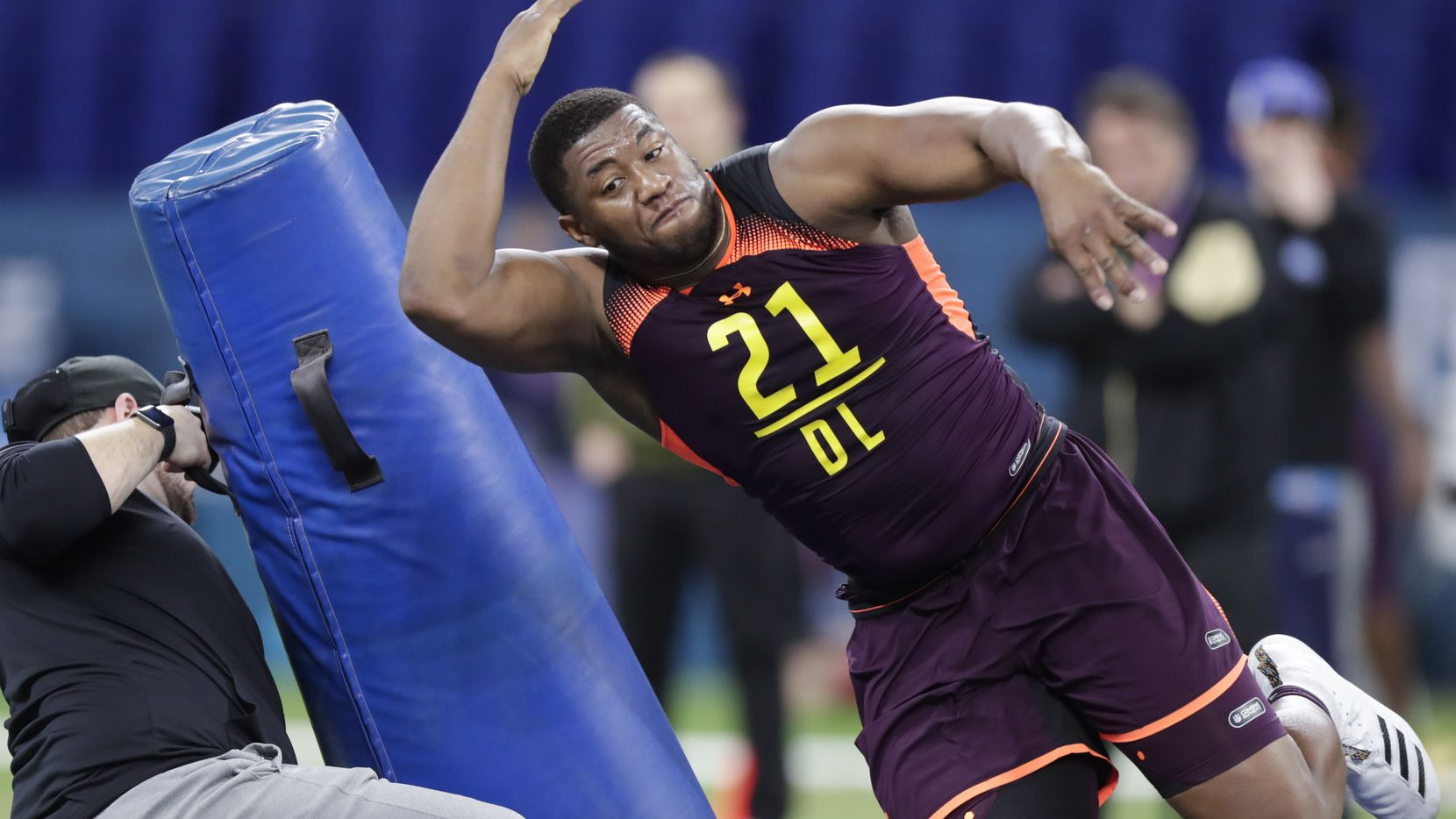 FILE - Kansas defensive lineman Daniel Wise runs a drill at the NFL football scouting combine in Indianapolis, Sunday, March 3, 2019. (AP Photo/Michael Conroy)