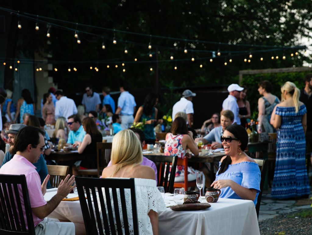 Guests dine outdoors during a supper club dinner at Magdalena's  in Fort Worth.