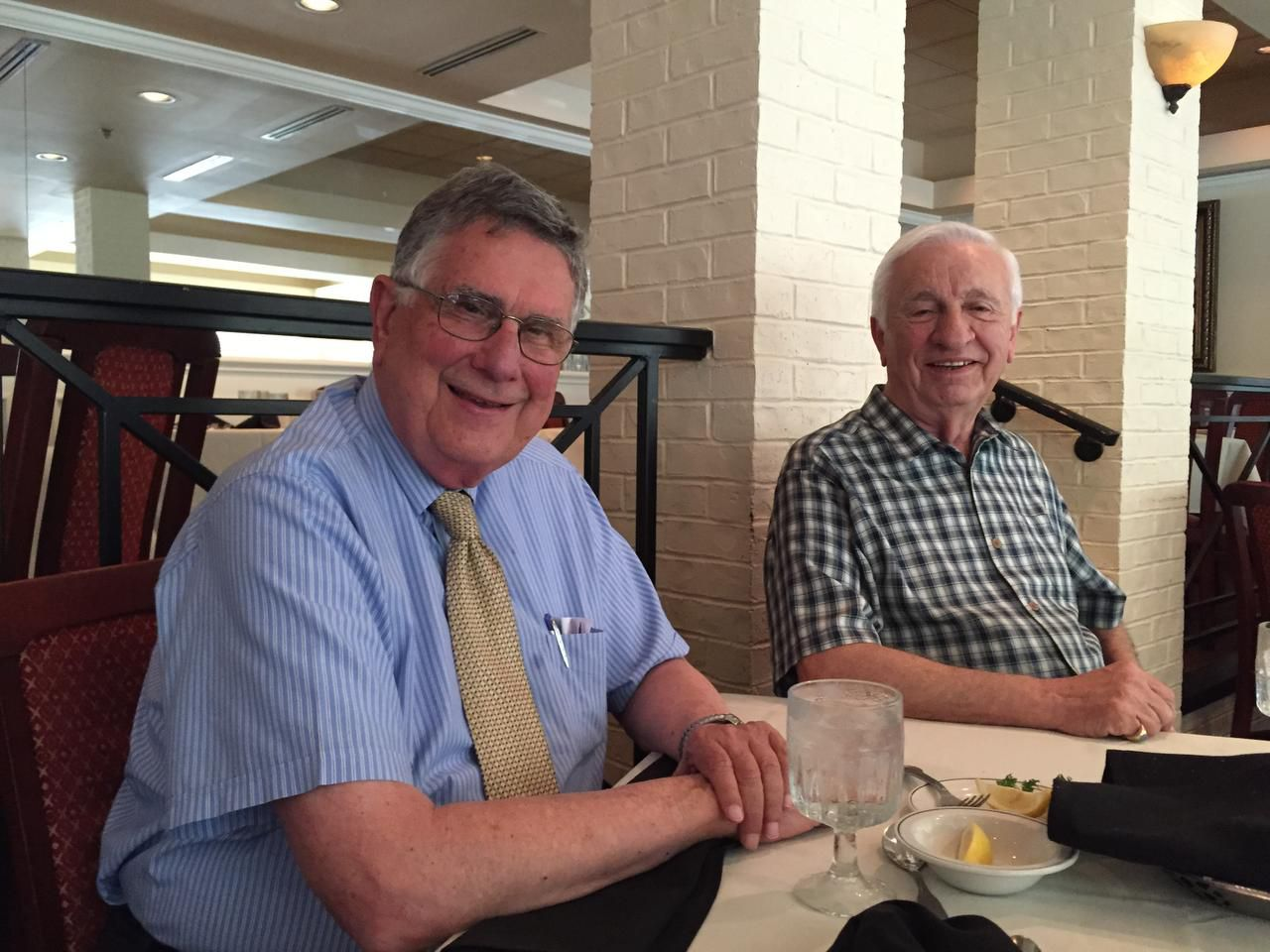 Jim Christon (left) and Angelo Stergios are shown at Vincent's Seafood in Plano on July 27.