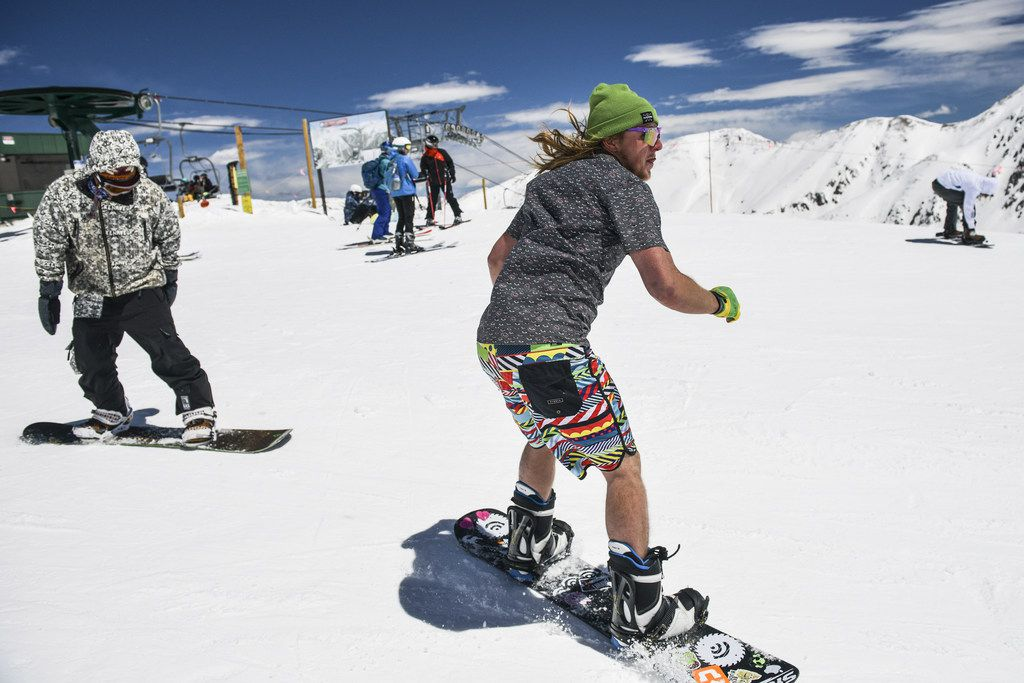 A snowboarder wearing shorts and a T-shirt enjoyed spring conditions at Arapahoe Basin Ski Area on Saturday in Dillon, Colo. Even as weekend temperatures pushed into the 50s, late-season snows have prompted Arapahoe Basin to announce plans to extend its season until at least June 16.