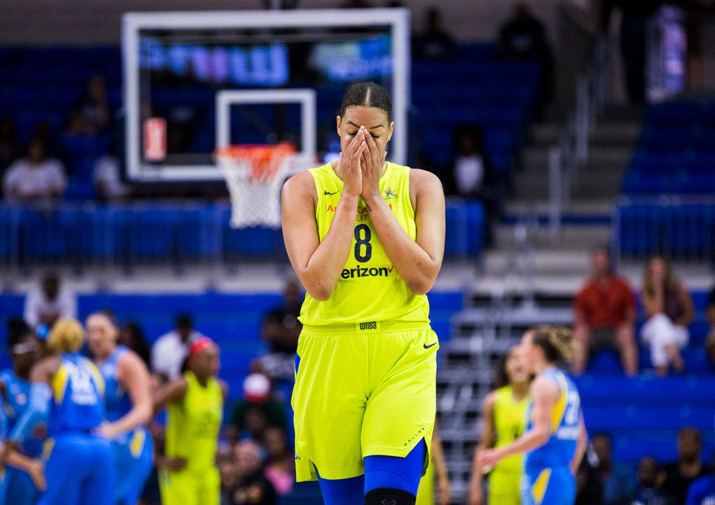 Dallas Wings center Liz Cambage (8) reacts after a play during the fourth quarter of a WNBA game between the Dallas Wings and the Chicago Sky on Tuesday, July 31, 2018 at College Park Center on the UTA campus in Arlington. (Ashley Landis/The Dallas Morning News)