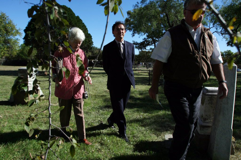Consul General of France Pierre Grandjouan, center, tours  La Reunion Cemetery with historical researcher Frances James, left, and Christopher Thevenet, a descendant of La Reunion colonists, on Nov. 04, 2010, in Dallas.