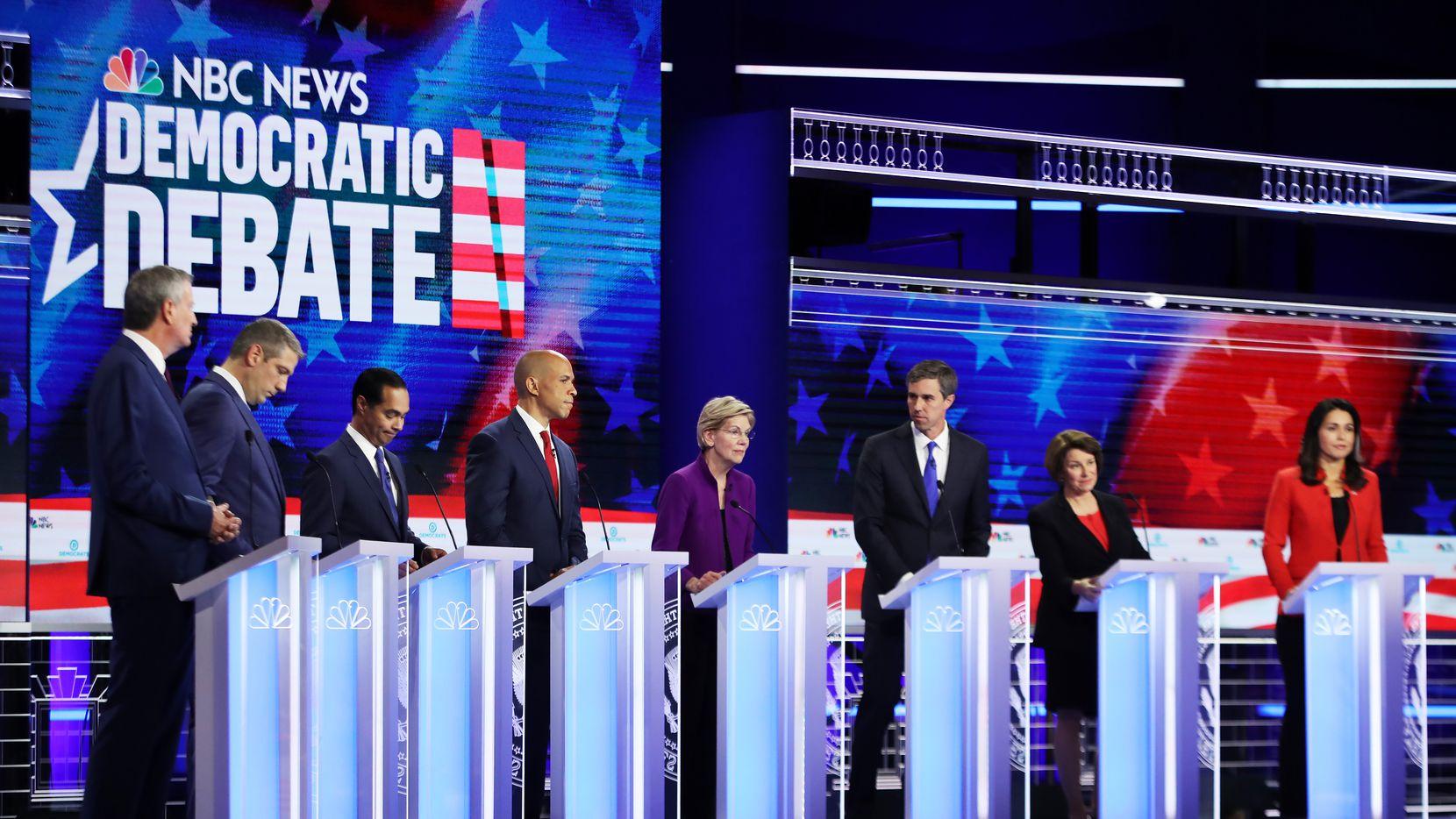 Democratic presidential candidates New York City Mayor Bill De Blasio (L-R), Rep. Tim Ryan (D-OH), former housing secretary Julian Castro, Sen. Cory Booker (D-NJ), Sen. Elizabeth Warren (D-MA), former Texas congressman Beto O'Rourke, Sen. Amy Klobuchar (D-MN) and Rep. Tulsi Gabbard (D-HI) take part in the first night of the Democratic presidential debate on June 26, 2019 in Miami, Fla.