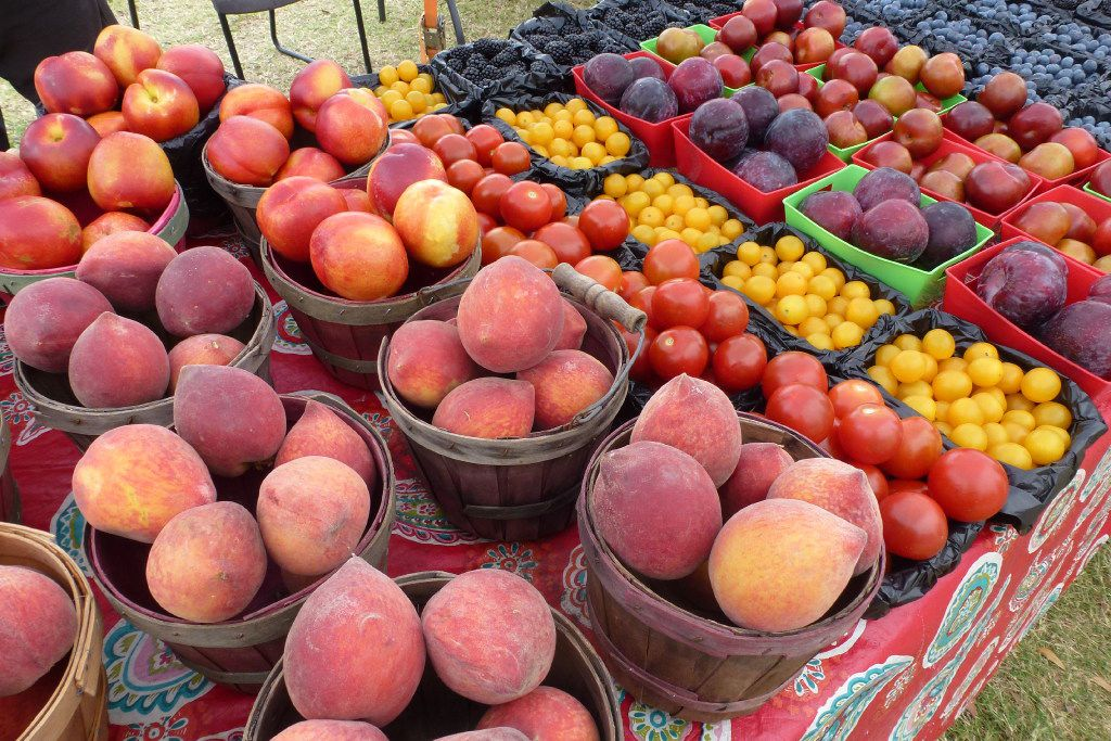 Brothers Rowdy and Roger Heddin each have a spot at the Firewheel farmers market, where peaches and plums are part of their seasonal harvest.