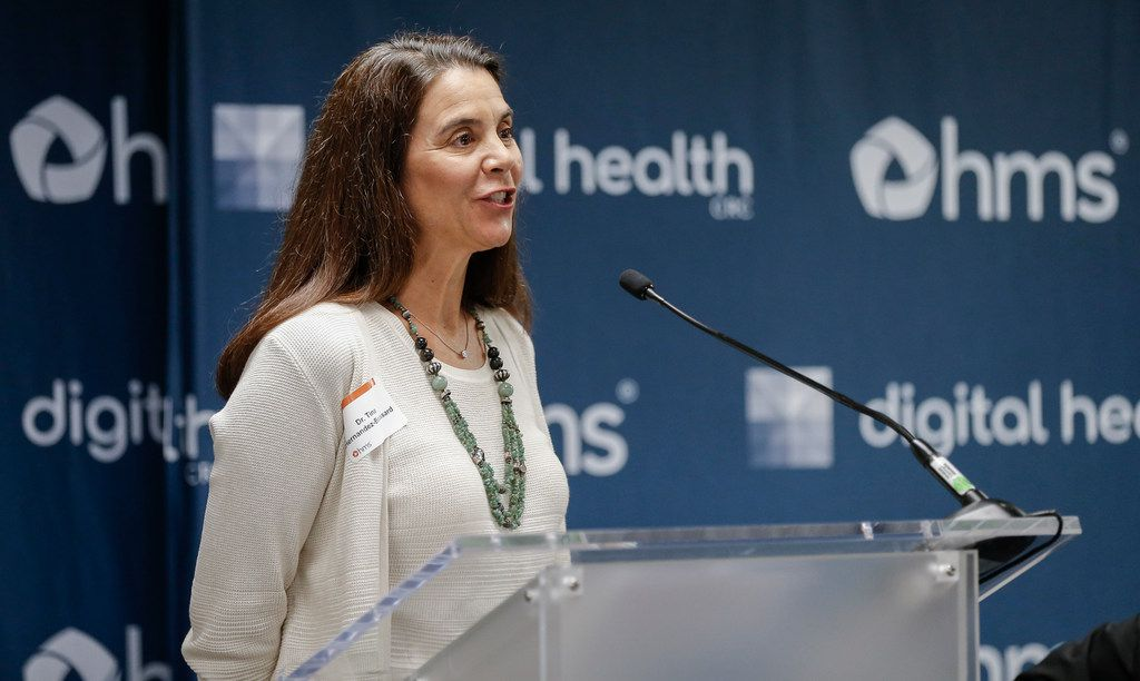Dr. Tina Hernandez-Boussard, associate professor of medicine at Stanford University, speaks during a press conference announcing a partnership with researchers at Stanford and HMS to fight opioid addiction, hospital re-admittance and other challenges.