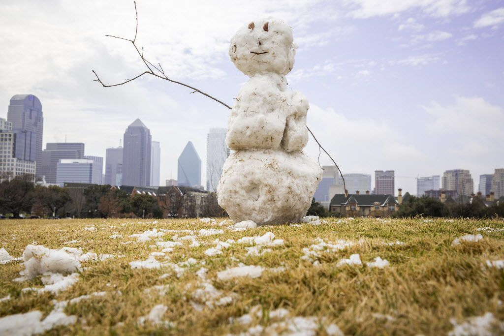 A snowman sits atop a small hill in Griggs Park near downtown Dallas after a winter storm dumped snow over North Texas on Wednesday, Feb. 25, 2015. (Smiley N. Pool/The Dallas Morning News)