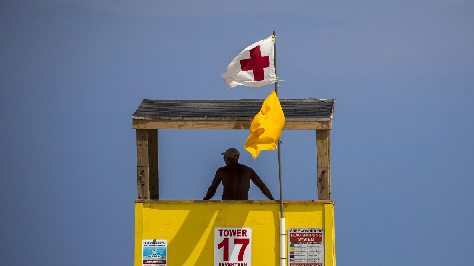A Port Aransas Beach Guard looks out from a tower in Port Aransas, Texas.