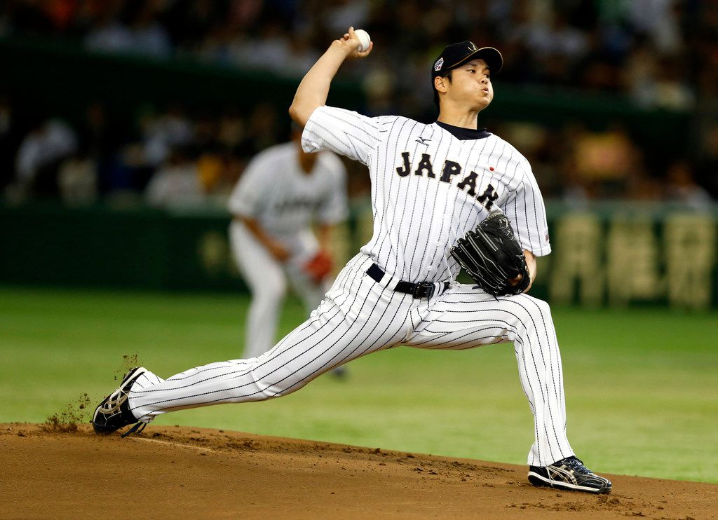 FILE - In this Nov. 19, 2015, file photo, Japan's starter Shohei Otani pitches against South Korea during the first inning of their semifinal game at the Premier12 world baseball tournament at Tokyo Dome in Tokyo. A person familiar with the decision says Major League Baseball owners on Friday, Dec. 1, 2017, have approved a new posting agreement with their Japanese counterparts in a move that allows bidding to start for coveted pitcher and outfielder Shohei Ohtani.   The person spoke on condition of anonymity because no announcement had been made.  (AP Photo/Toru Takahashi, File)