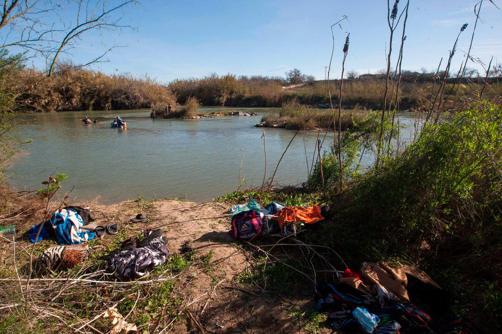 Immigrants left belongings they couldn't carry across the river to the U.S. side of the border.
