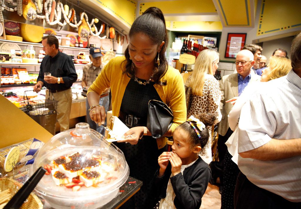 Jennifer Gilmore and her 6-year-old daughter, Jocelyn, of Fort Worth sample food during VIP night at the new Eatzi's Market & Bakery at University Park Village in Fort Worth on May 9.