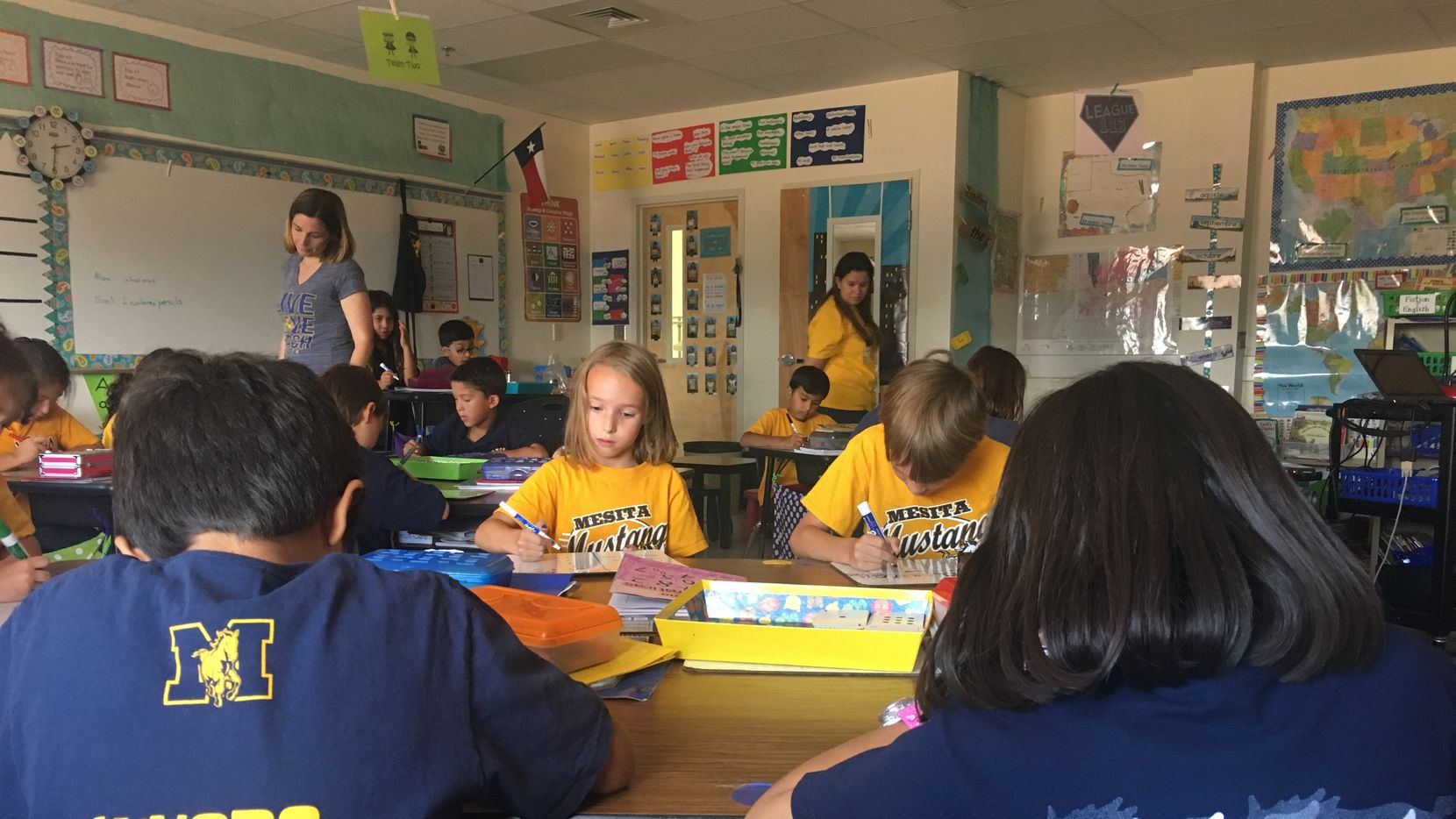 Students enrolled in a  second grade dual-language class in El Paso at Mesita Elementary work on math problems. Their teacher, Jill McGee, uses Spanish for half the day and English the other half to teach a variety of subjects.