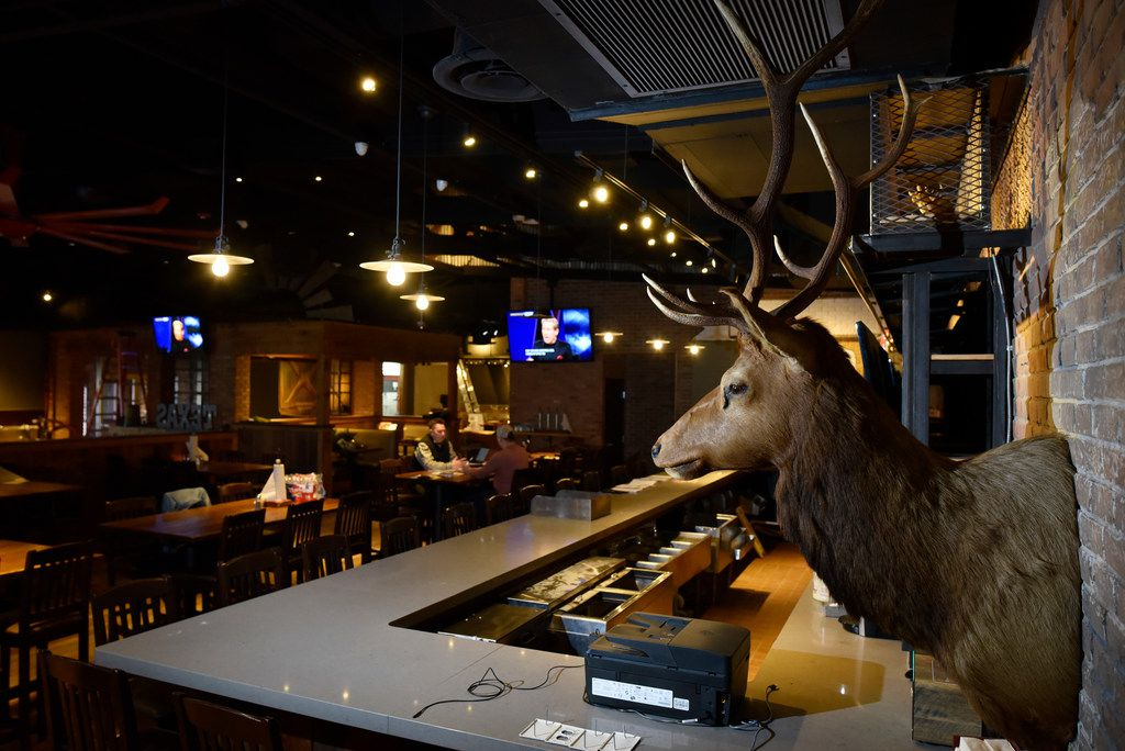 Deer heads decorate the bar area inside the new Tender Smokehouse in Frisco.