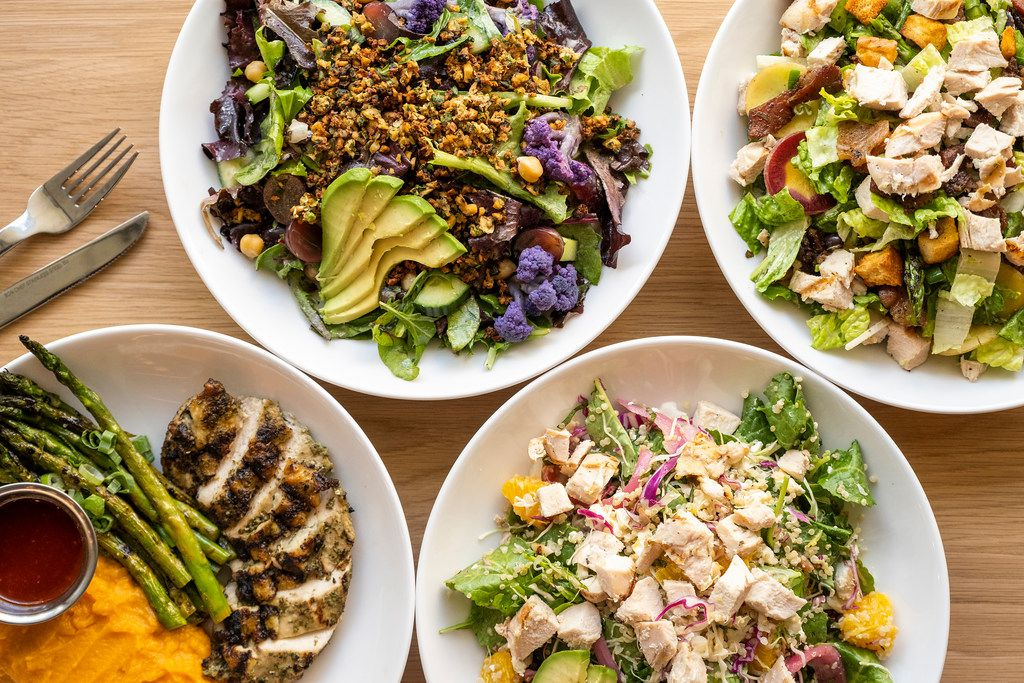 Clockwise from top left, Falaf salad, Wrangler spring salad, Zesty grain bowl and a Seasonal plate featuring herb roasted chicken breast with a spicy Korean bbq sauce and market sides of grilled asparagus and mashed sweet potatoes at Mixt  in Uptown on Tuesday, May 7, 2019, in Dallas. (Smiley N. Pool/The Dallas Morning News)