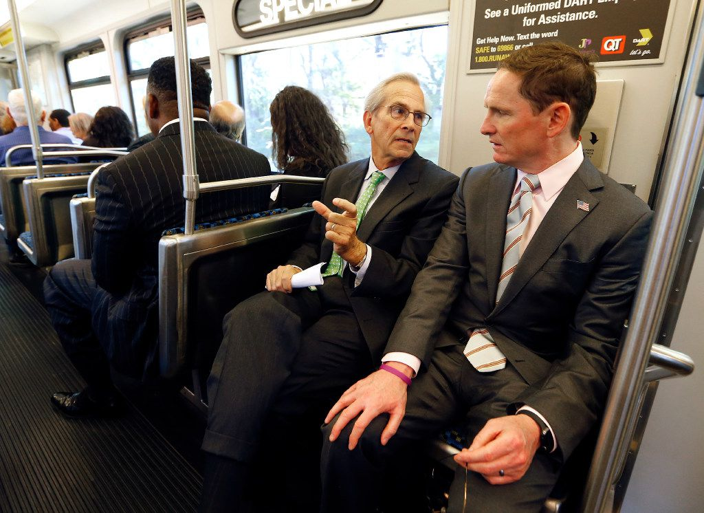 Dallas County Judge Clay Jenkins (right) visits with former Dallas County Judge and Chancellor of the University of North Texas System Lee Jackson on the inaugural ride to the newly finished UNT Dallas Station on the Blue Line in southeast Oak Cliff on Oct. 20.
