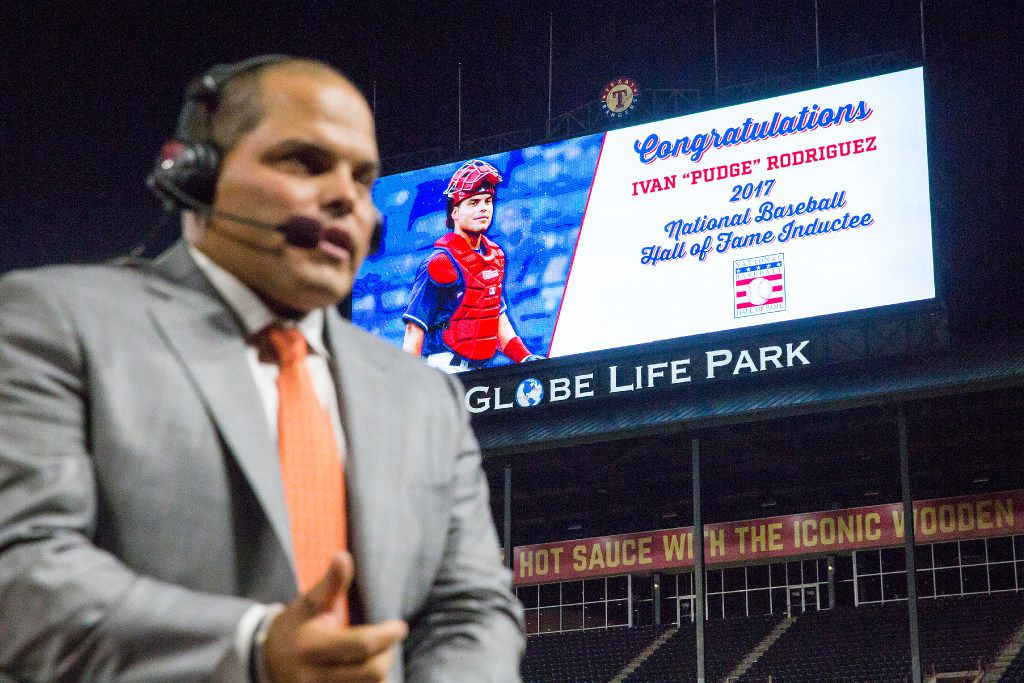 The scoreboard features congratulation behind him as former Texas Rangers catcher Ivan 'Pudge' Rodriguez does a TV interview at Globe Life Park after the announcement that he was voted into the Hall of Fame on Wednesday, Jan. 18, 2017, in Arlington. Rodriguez, who signed with the Rangers at 16 and made his major league debut before turning 20, was elected to the Hall in his first year on the ballot, joining Johnny Bench as the only catchers in baseball history to be elected in the first year of eligibility.(Smiley N. Pool/The Dallas Morning News)