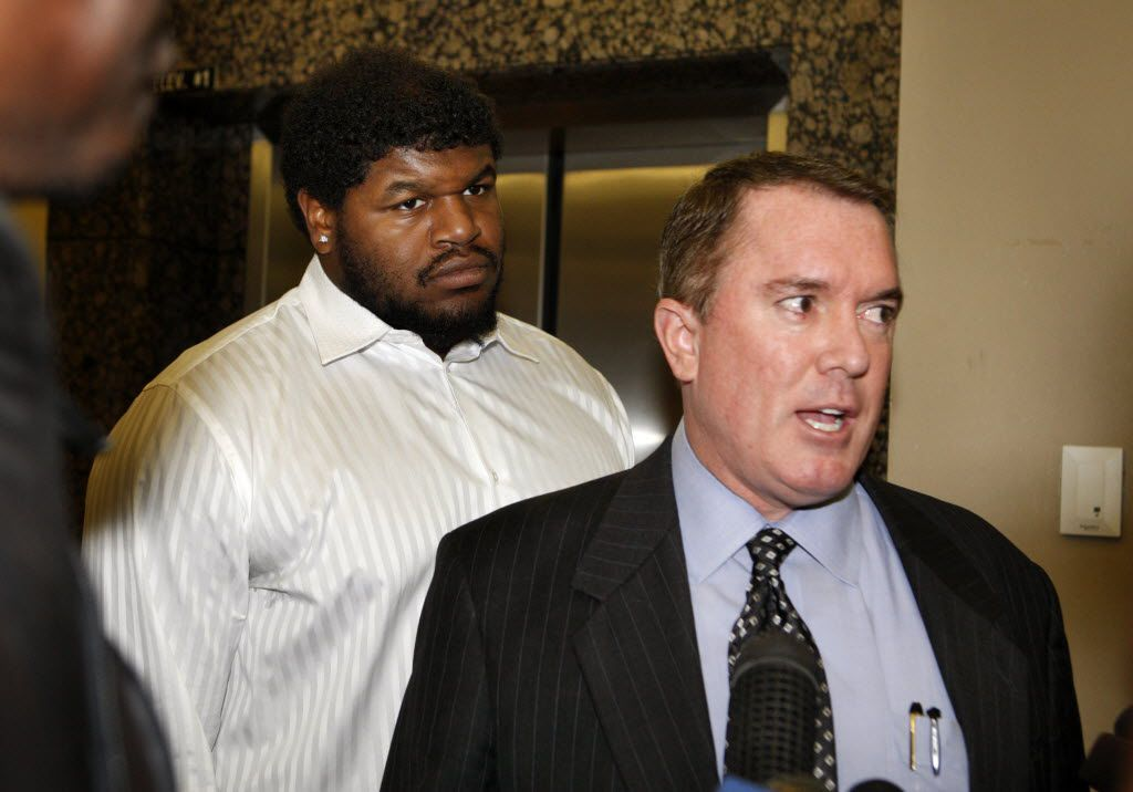 Josh Brent and one of his attorneys, George Milner III, spoke with reporters at hearing before Brent's 2014 criminal trial. Brent was convicted of intoxication manslaughter, but a jury gave him probation.