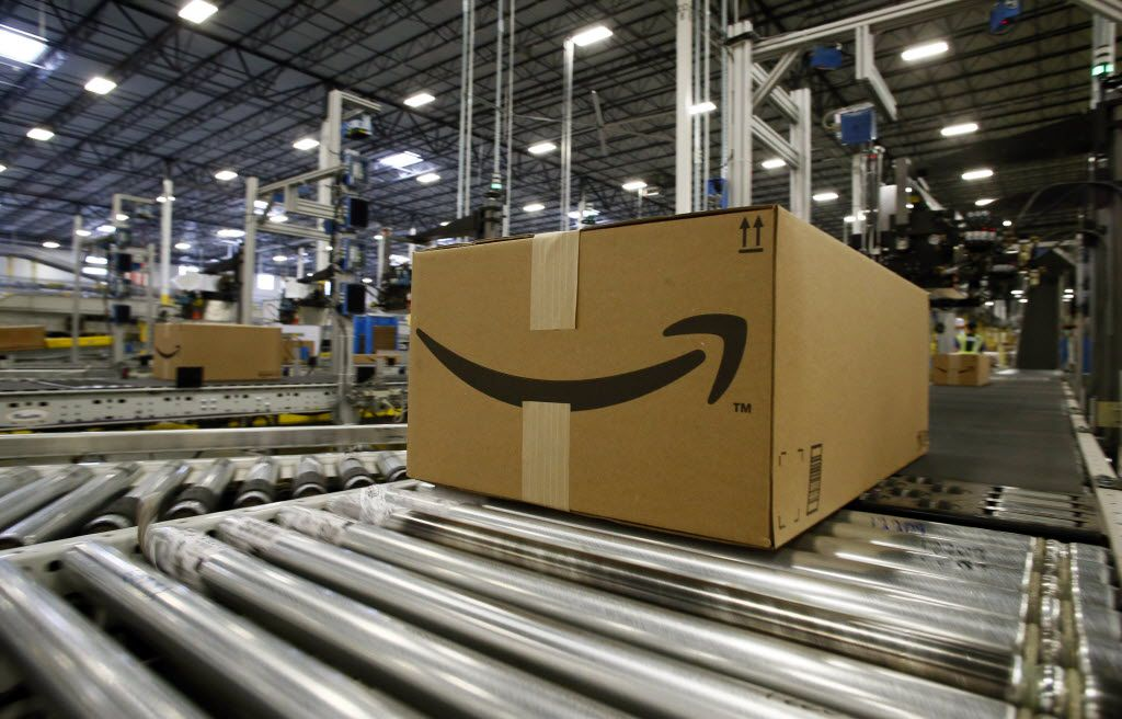 All boxes at the Amazon.com fulfillment center have their logo facing up in Coppell, Texas. File photo.  (Nathan Hunsinger/The Dallas Morning News)