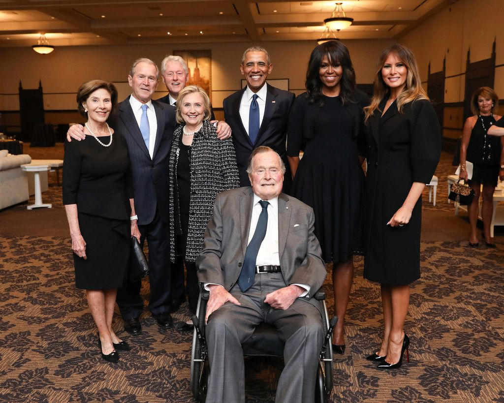This April 21, 2018, photo provided by the Office of former President George H.W. Bush, shows Bush, front center, and past presidents and first ladies, from left, Laura Bush, George W. Bush, Bill Clinton, Hillary Clinton, Barack Obama, Michelle Obama and current first lady Melania Trump. They had gathered in Houston for a funeral service for former first lady Barbara Bush. (Paul Morse/Courtesy of Office of George H.W. Bush via AP)