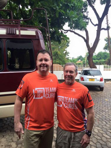 Dallas oncologist Brian Berryman and patient Chuck Wakefield at the base of Mount Kilimanjaro