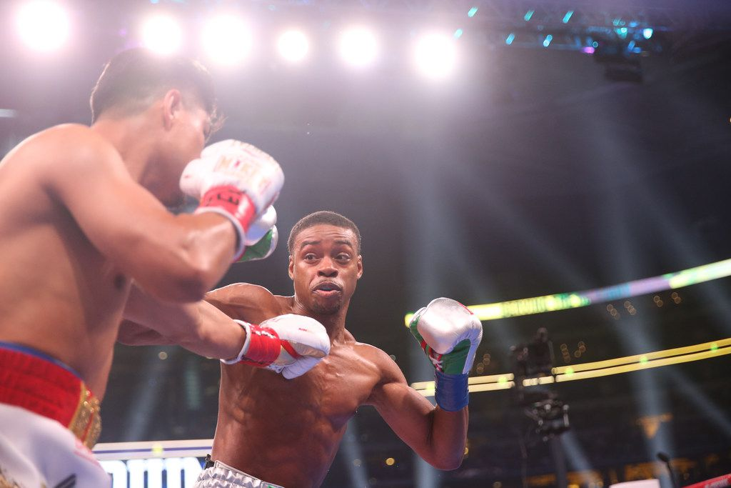 Errol Spence Jr., right, fights Mikey Garcia, left, during a IBF World Welterweight Championship match on March 16, 2019 at AT&T Stadium in Arlington, Texas. (Ryan Michalesko/The Dallas Morning News)
