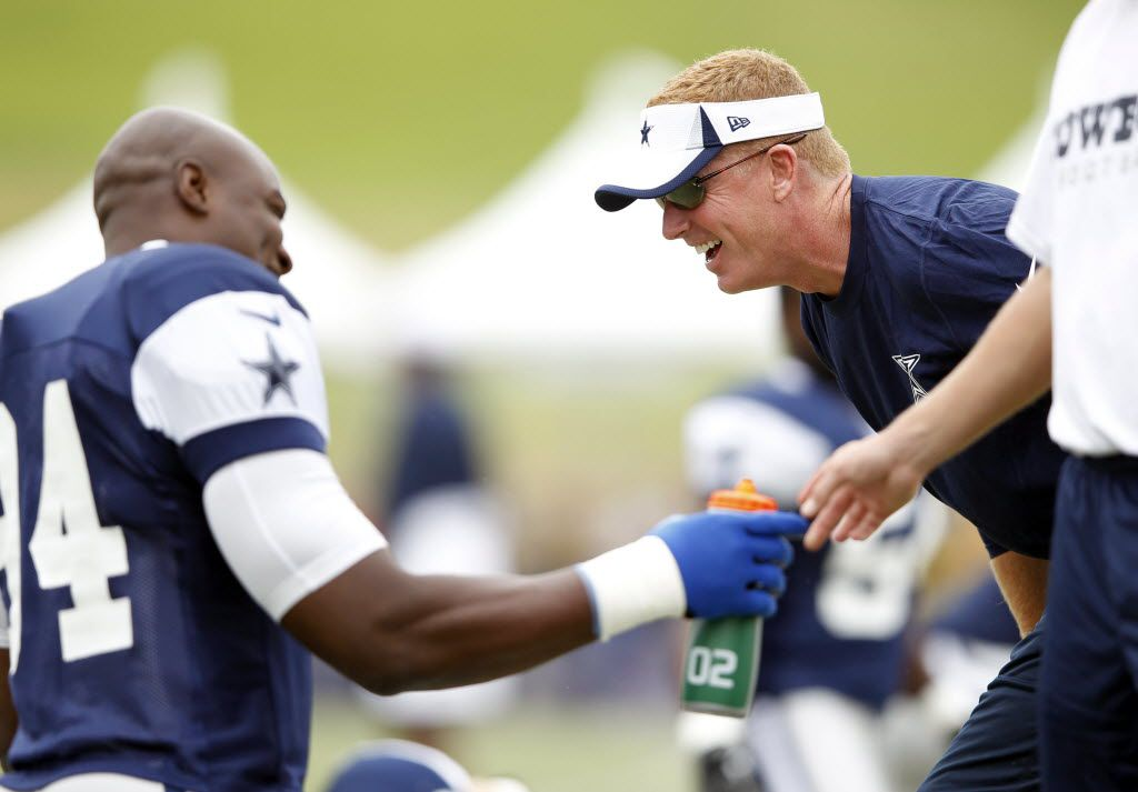 Dallas Cowboys head coach Jason Garrett and Dallas Cowboys defensive end DeMarcus Ware (94) share a laugh during stretching time at practice at Dallas Cowboys training camp in Oxnard, California on July 28, 2013. (Vernon Bryant/The Dallas Morning News)