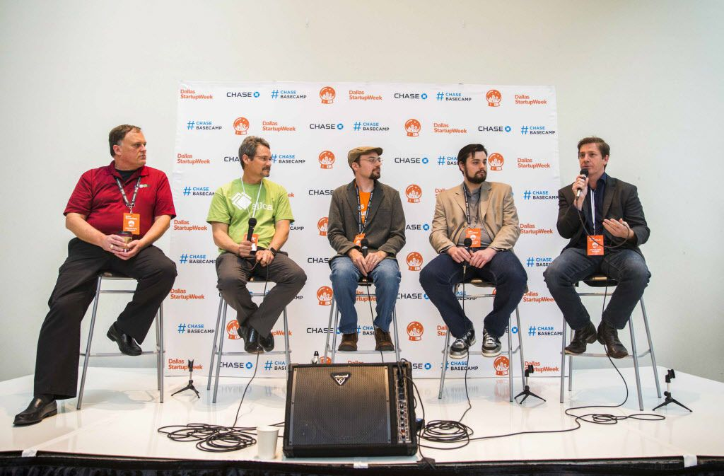 (From left) Dan Kardell of GeoWhiz, Daniel Cocanougher of AllCal, moderator Kevin Kirkpatrick, Nolan Clemmons of Wufasta and Todd McGee of Cataboom participate in a panel discussion about marketing through gaming during Dallas Startup Week on Tuesday, April 12, 2016 at 1700 Pacific Avenue in downtown Dallas.  (Ashley Landis/The Dallas Morning News)