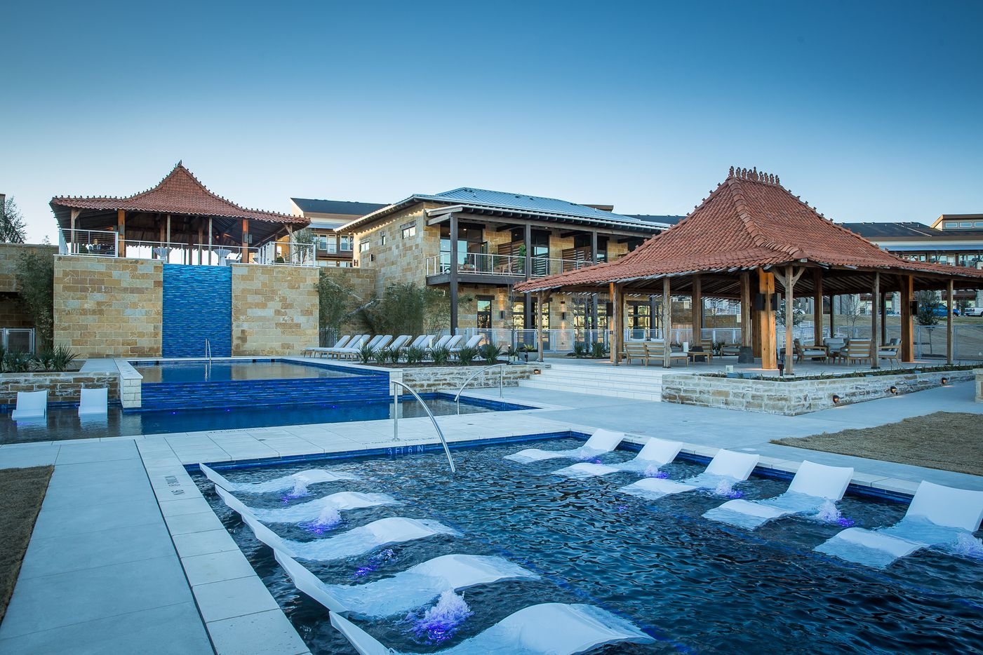The new Hudson apartments at Austin Ranch have a resort style pool with pavilions that were brought from Indonesia.
