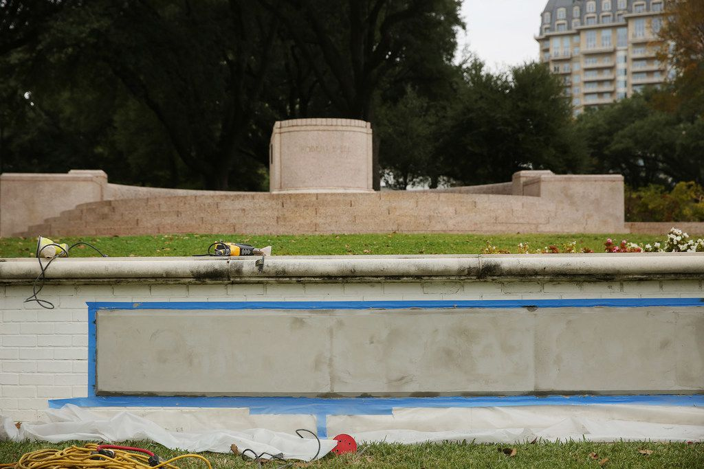 """A view of where workers covered over a sign denoting the former """"Robert E. Lee Park"""" at the newly renamed Oak Lawn Park in Dallas on Nov. 7, 2017. The Dallas Park Board unanimously voted to temporarily revert the 14.1 acres of green space back to its original name: Oak Lawn Park."""