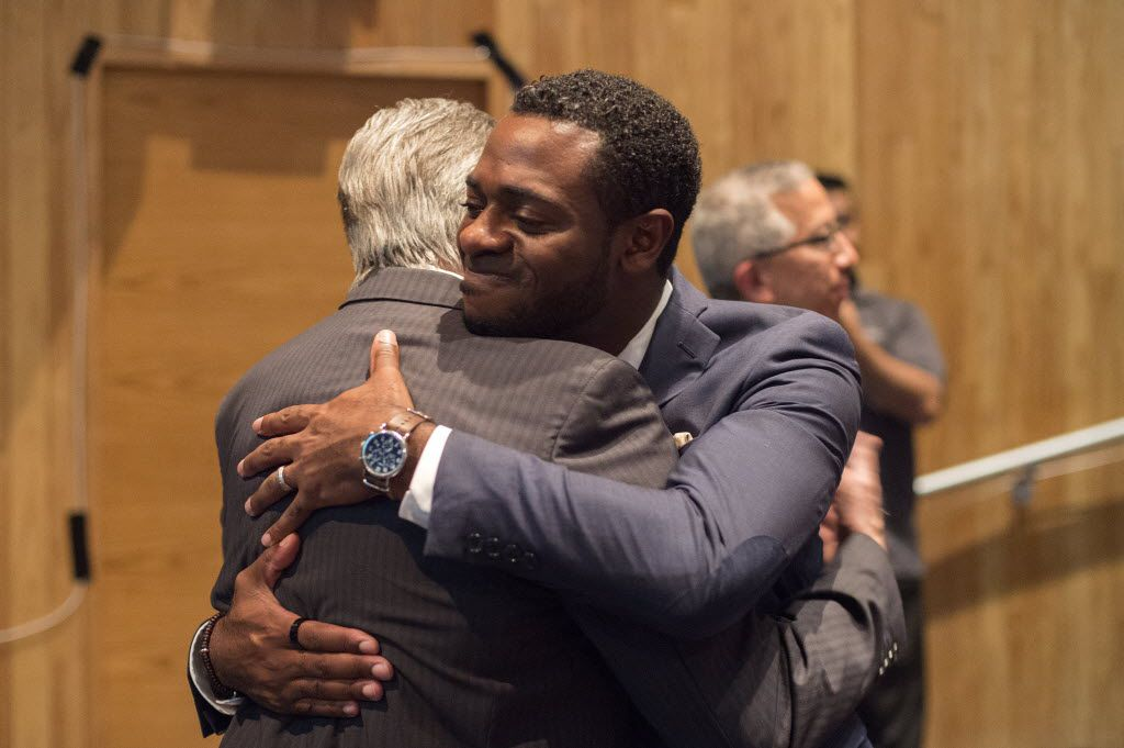 Dallas Festival of Ideas steering committee members Byron Sanders, right, and Larry Allums share a hug during Actions Speak Louder, a forum on race relations hosted by the Dallas Festival of Ideas on July 29, 2016 at El Centro College in downtown Dallas. (Jeffrey McWhorter/Special Contributor)