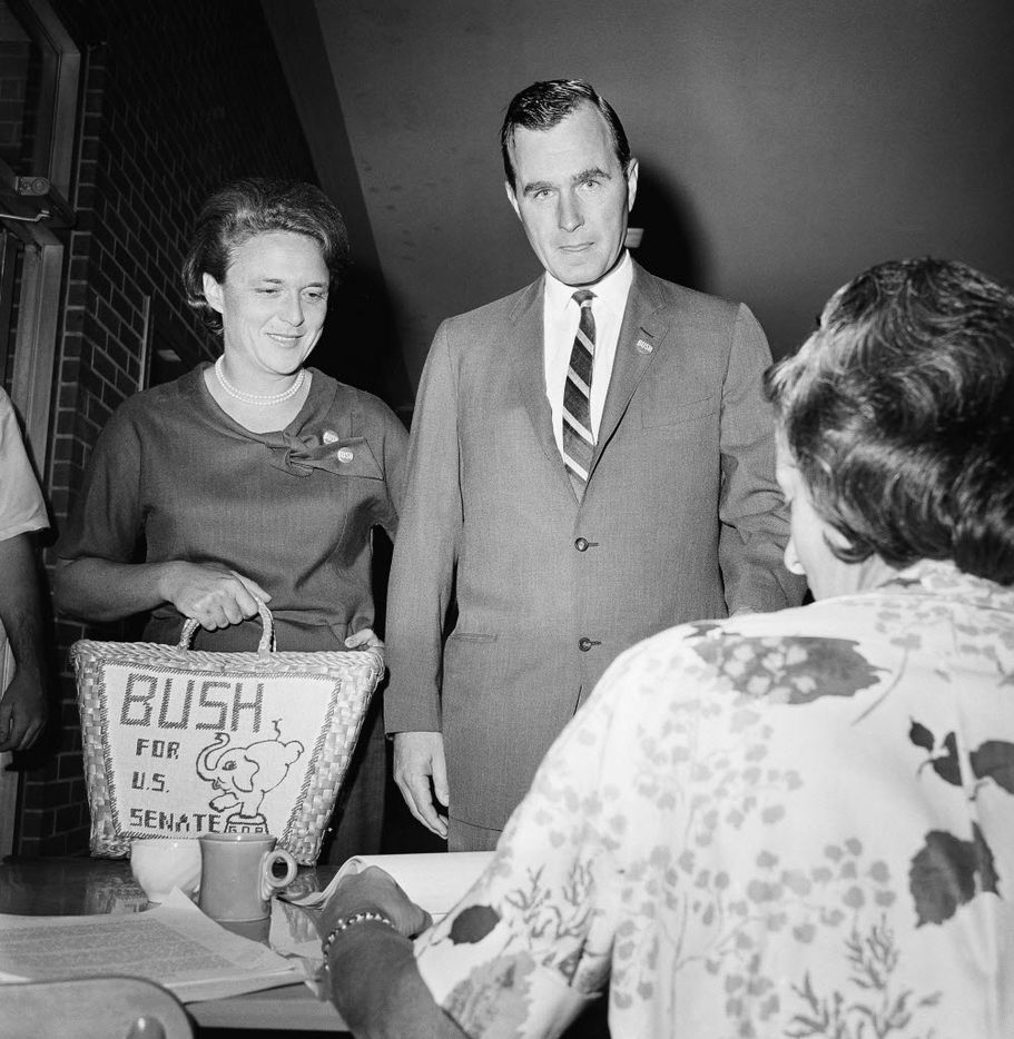 George Bush and his wife Barbara cast their votes in Houston for the Texas senate primary race June 6, 1964.   Bush is seeking the Republican victory over opponent Jack Cox.  The Republican winner will oppose Sen. Ralph Yarborough in the November general election. (AP Photo/ Ed Kolenovsky)