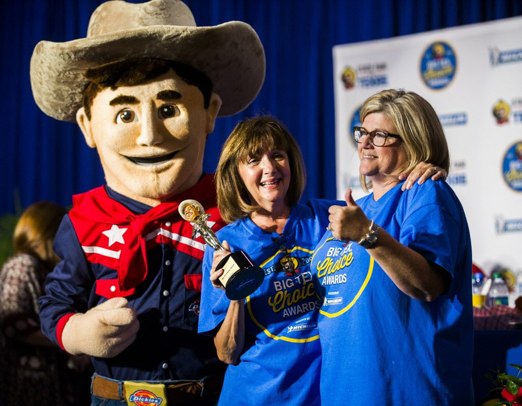 Christi Erpillo and Johnna McKee, creators of Fernie's Holy Moly Carrot Cake Roly, pose with the Big Tex mascot on Sunday after the Big Tex Choice Awards.