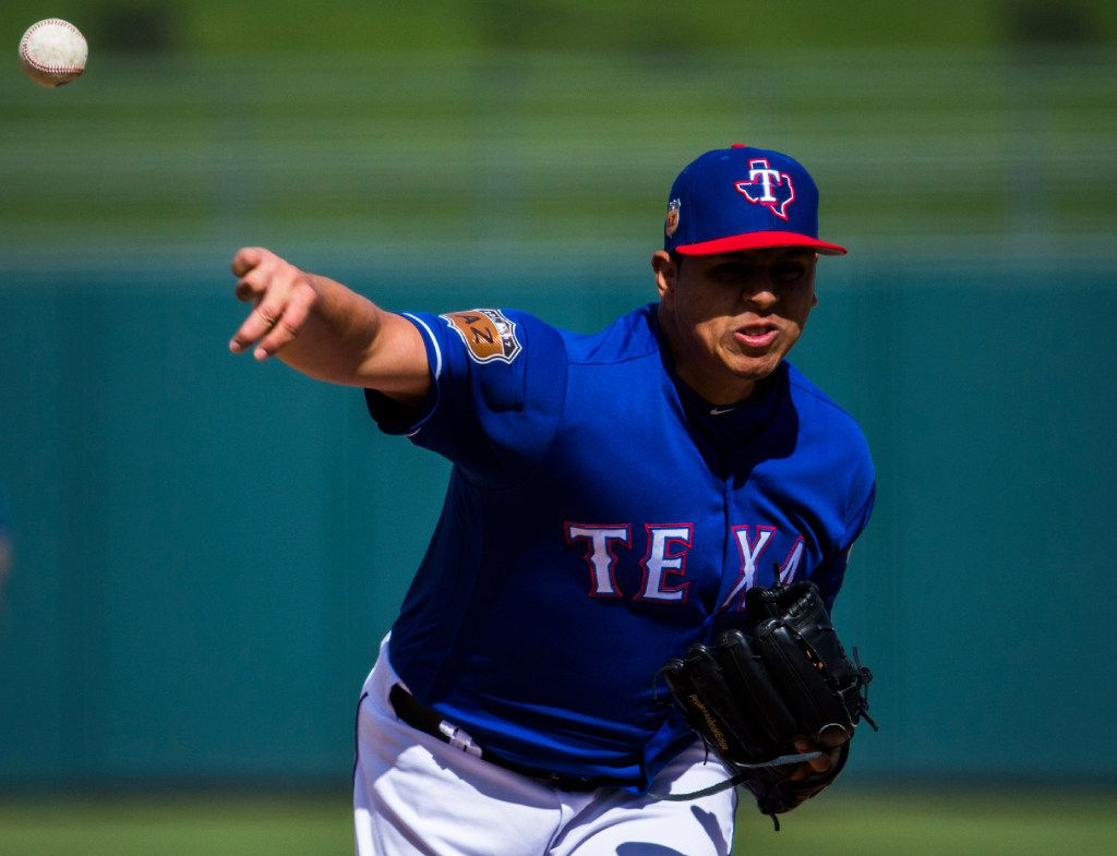 Texas Rangers starting pitcher Ariel Jurado (74) pitches during the fifth inning of a spring training game against the Arizona Diamondbacks at the teams' training facility on Tuesday, February 28, 2017 in Surprise, Arizona. (Ashley Landis/The Dallas Morning News)