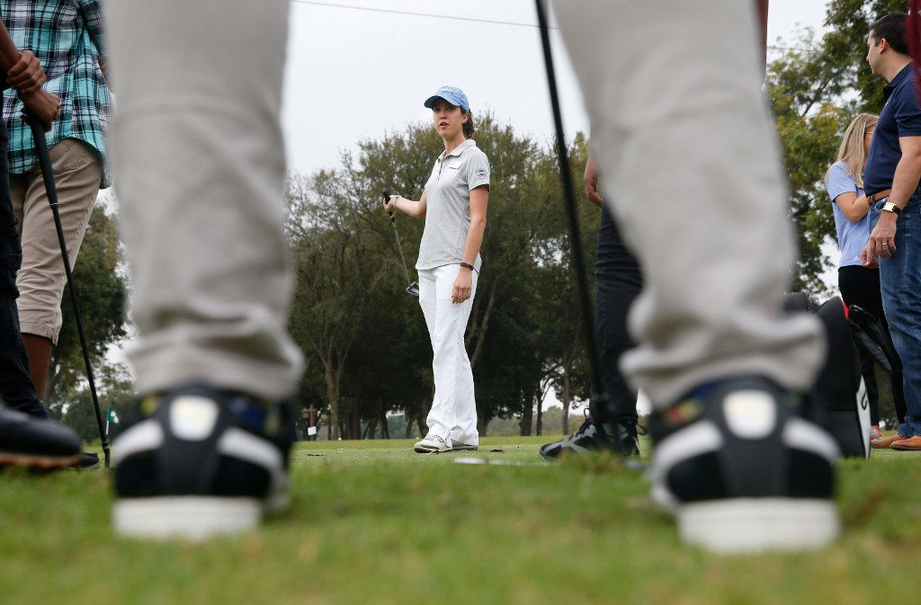 Alyssa Richardson, with North Texas PGA, teaches students about putting during Fairway to Success golf program at  Keeton Park Golf Course in Dallas.  (Nathan Hunsinger/The Dallas Morning News)
