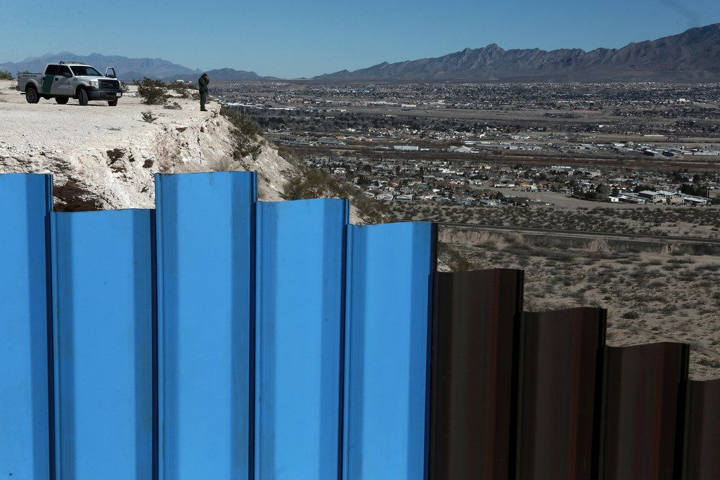 A border fence separates the towns of Anapra, Mexico and Sunland Park, N.M.