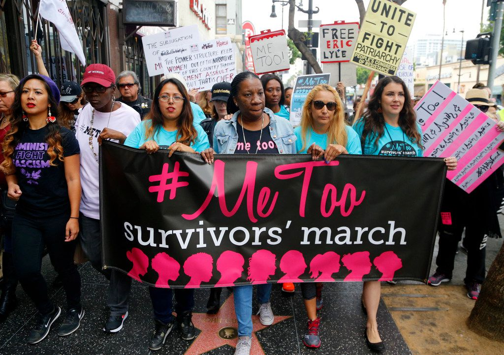 In this Nov. 12, 2017 file photo, participants march against sexual assault and harassment at the #MeToo March in the Hollywood section of Los Angeles.