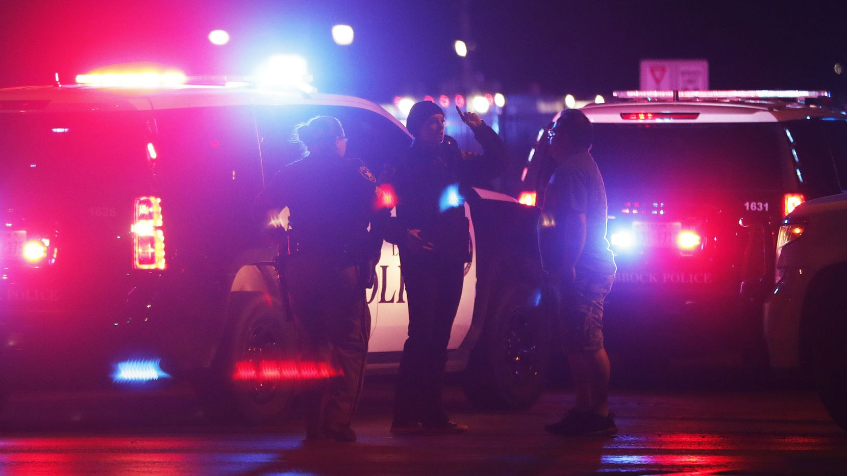 Emergency personnel gathered at an intersection across from Talkington Hall on the Texas Tech University campus  in Lubbock on Monday. (Mark Rogers/Lubbock Avalanche-Journal)