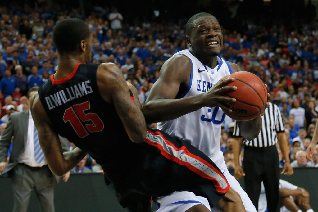 ATLANTA, GA - MARCH 15:  Julius Randle #30 of the Kentucky Wildcats drives with the ball against Donte' Williams #15 of the Georgia Bulldogs during the semifinals of the SEC Men's Basketball Tournament at Georgia Dome on March 15, 2014 in Atlanta, Georgia.  (Photo by Kevin C. Cox/Getty Images)