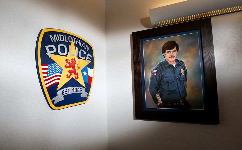A portrait of George Raffield Jr. by artist James Spurlock is on display at the Midlothian Police Department on Oct. 18, 2017.