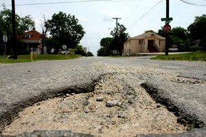 A pothole on Madison Avenue near Eighth Street in Oak Cliff in June 2010. (File Photo)