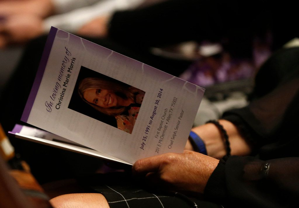 An attendee holds a program before a memorial service for Christina Morris at First Baptist Church in Allen.