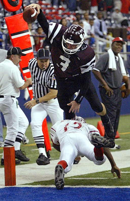 Wylie's Jeremy Brubaker (3) soars over Woodrow Wilson's Mark McCleary (12) in a Class 4A Division 2 Region 2 area round high school football playoff game at Texas Stadium in Irving, Friday, November 19, 2004. (Vernon Bryant/The Dallas Morning News)