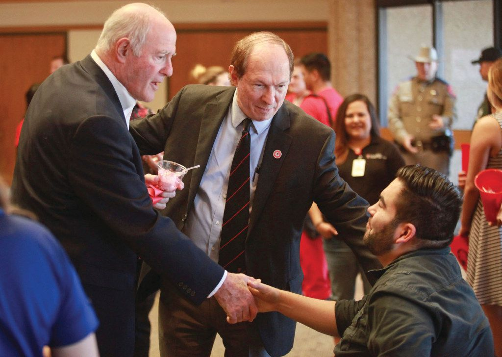 Sen. Kel Seliger, left, is introduced to John Garcia, right, the designated institutional official for graduate medical education, by Gary Ventolini the Texas Tech University Health Sciences Center school of Medicine regional dean and professor during an ice cream social at the TTUHSC Permian Basin Campus Rotunda Friday, Feb. 24, 2017, in Odessa, Texas. (AP Photo|Odessa American, Jacob Ford)