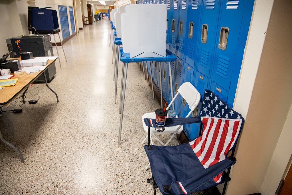 A chair featuring an American flag pattern sits at the John F. Peeler Elementary School, precinct 4070, polling station in Oak Cliff on Saturday. In Dallas County, more votes were cast during early voting than on Election Day.