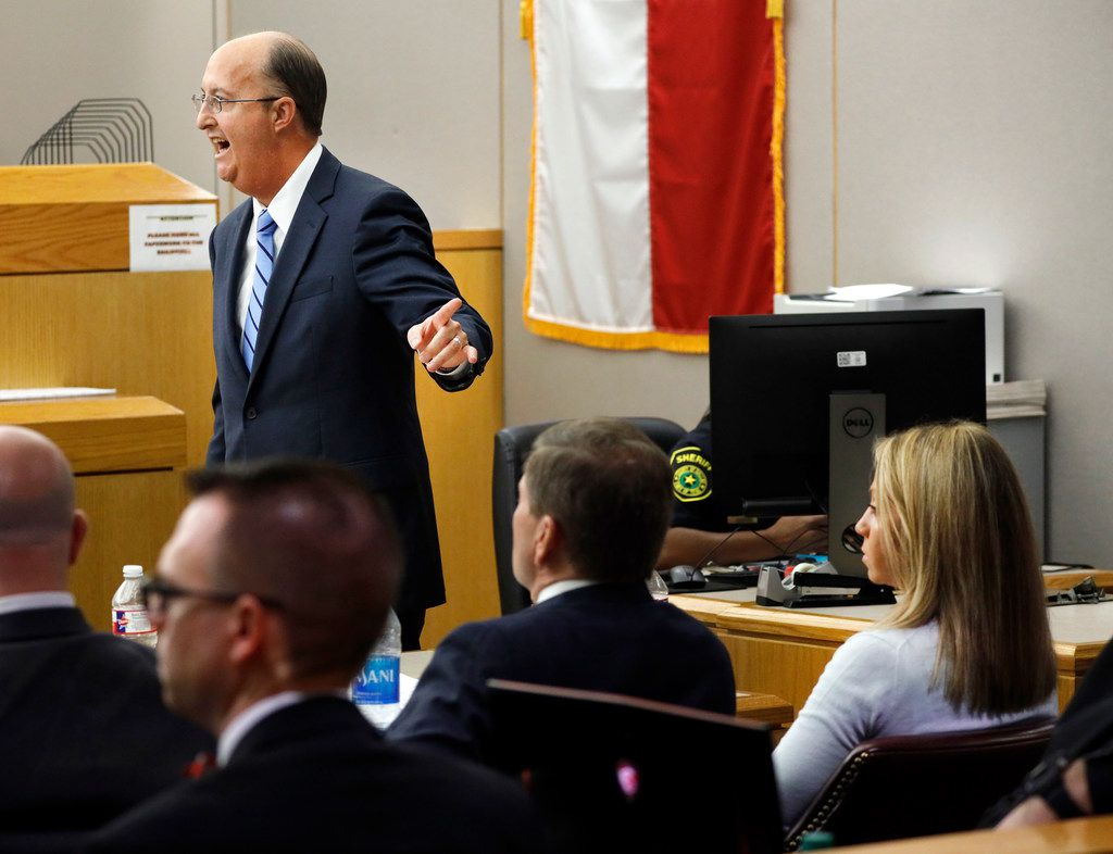 Defense attorney Robert Rogers (left) points to his client, Amber Guyger, during closing arguments in her murder trial Monday, Sept. 30, 2019. The jury has now taken the case for decision.