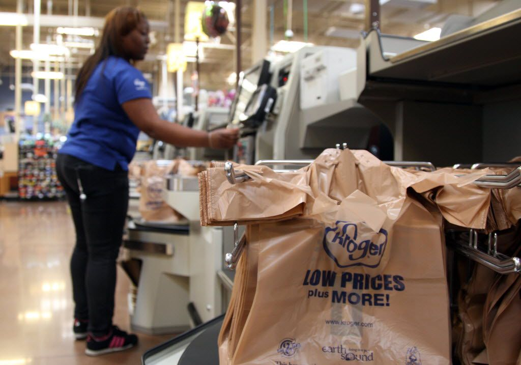 Kroger cashier Guinvera Jordan resets a self checkout machine at the Kroger Capitol Street location in Dallas, Texas on Friday, June 7, 2013. The Dallas City Council will debate whether to ban stores from using the plastic bags.