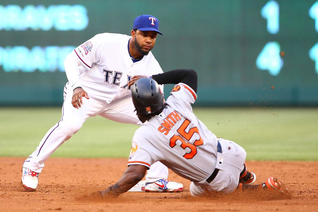 Infielder Elvis Andrus of the Texas Rangers tags out the Baltimore Orioles' Dwight Smith Jr. (35) stealing second base in the third inning at Globe Life Park in Arlington on Tuesday, June 4, 2019, in Arlington, Texas. The Orioles won, 12-11. (Rick Yeatts/Getty Images/TNS) **FOR USE WITH THIS STORY ONLY**