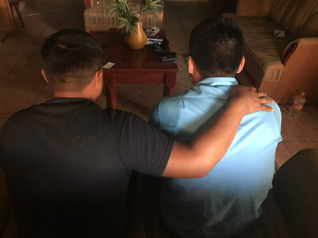 A brother consoles Francisco Narciso, who was kidnapped after being deported to Nuevo Laredo, Mexico. Another brother was murdered recently.
