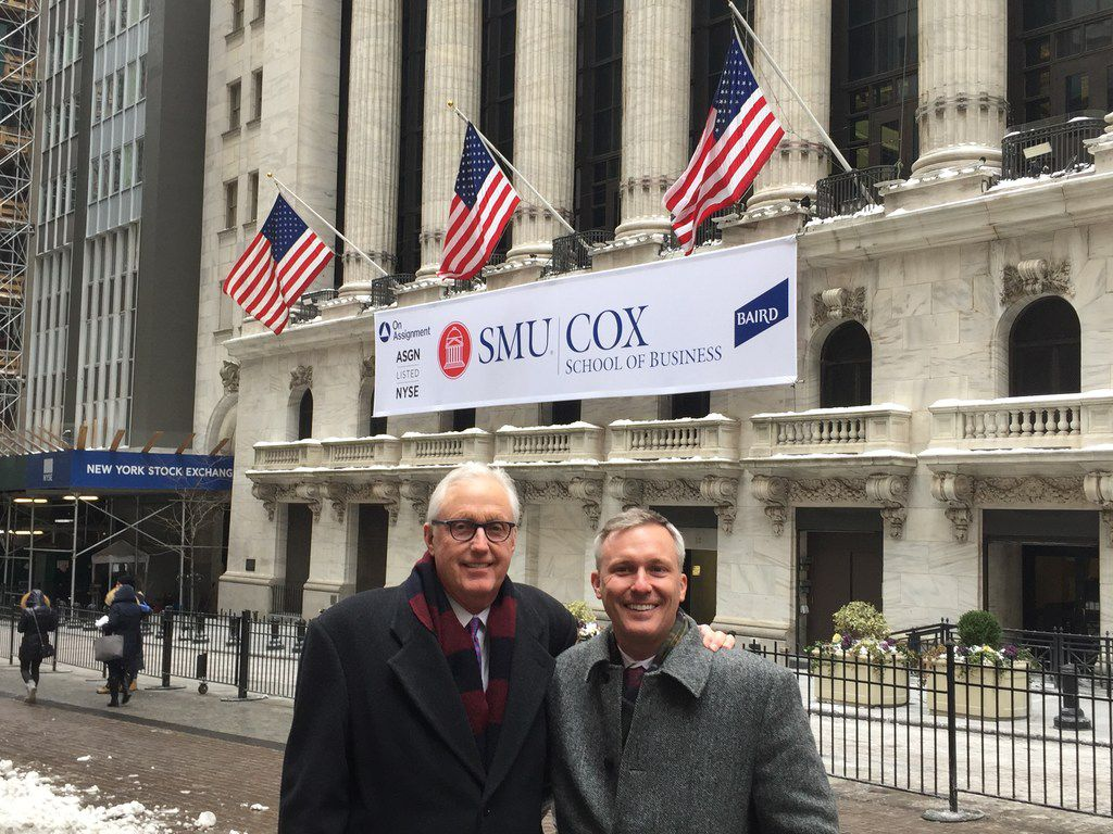David Miller and his son, Kyle, stand in front of the New York Stock Exchange on Jan. 8 when SMU's Cox School of Business rang the closing bell.