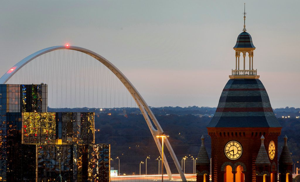 The Margaret McDemott Bridge looms behind the Hyatt Regency hotel (left) and the Old Red Courthouse in downtown Dallas on Dec. 2, 2017.
